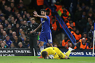 Goalkeeper Iker Casillas of FC Porto dives to try and get Diego Costa of Chelsea booked for fouling. UEFA Champions league group G match, Chelsea v Porto at Stamford Bridge in London on Wednesday 9th December 2015.<br /> pic by John Patrick Fletcher, Andrew Orchard sports photography.