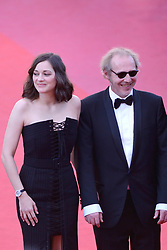 Marion Cotillard and Arnaud Desplechin arriving at Les Fantomes d'Ismael screening and opening ceremony held at the Palais Des Festivals in Cannes, France on May 17, 2017, as part of the 70th Cannes Film Festival. Photo by Aurore Marechal/ABACAPRESS.COM