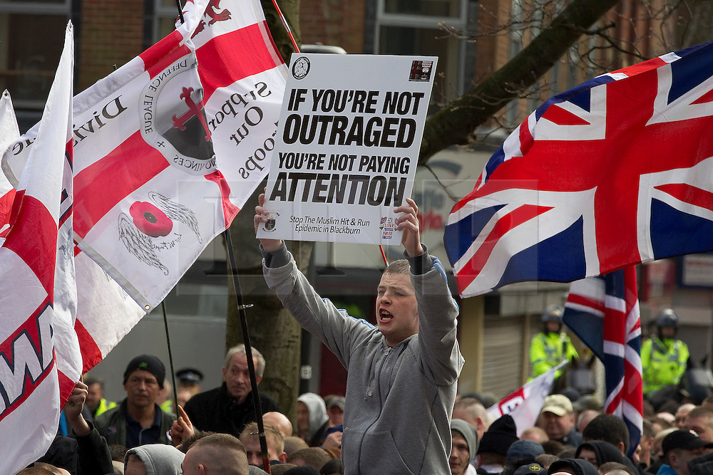 """© under license to London News Pictures. 02/04/2011: The English Defence League hold a rally in Blackburn.About 2000 EDL supporters were in attendance. It was one of the largest policing operations Lancashire police have ever put in to action. Credit should read """"Joel Goodman/London News Pictures""""."""