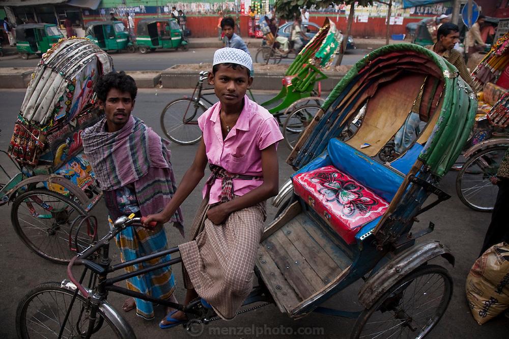 A rickshaw driver waits for customers at the Central Train Station in Dhaka, Bangladesh.