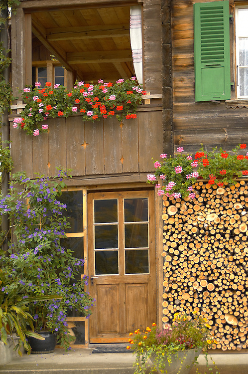 Interlaken Bernese Alps Switzerland - Wood stacked outside Swiss wooden house .<br /> <br /> Visit our SWITZERLAND  & ALPS PHOTO COLLECTIONS for more  photos  to browse of  download or buy as prints https://funkystock.photoshelter.com/gallery-collection/Pictures-Images-of-Switzerland-Photos-of-Swiss-Alps-Landmark-Sites/C0000DPgRJMSrQ3U