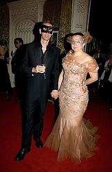 Photographer NICK KNIGHT and his wife CHARLOTTE at the 2006 Moet & Chandon Fashion Tribute in honour of photographer Nick Knight, held at Strawberry Hill House, Twickenham, Middlesex on 24th October 2006.<br /><br />NON EXCLUSIVE - WORLD RIGHTS
