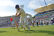 Alastair Cook of England stretching as he walks out to bat during the first day of the 4th SpecSavers International Test Match 2018 match between England and India at the Ageas Bowl, Southampton, United Kingdom on 30 August 2018.