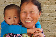 Grandmother and baby, in the harbour where the Maritime Silk Road started, during many centuries, near Xu Wen, Guangdong province, China