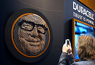 A Berkshire Hathaway shareholder shoots a picture of a portrait of Berkshire CEO Warren Buffet made out of Duracell batteries at the Berkshire Hathaway annual meeting in Omaha, Nebraska, U.S. May 6, 2017. REUTERS/Rick Wilking