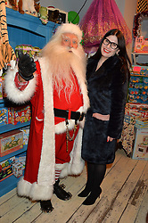 LONDON, ENGLAND 1 DECEMBER 2016: Father Christmas, Sarah Reygate at the 10th birthday party for the toy shop HoneyJam, 2 Blenheim Crescent, Notting Hill, London, England. 1 December 2016.
