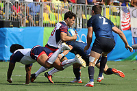 August 09, 2016; Rio de Janeiro, Brazil; USA Men's Eagles Sevens Madison Hughes is caught by the Argentinian defense during the Men's Rugby Sevens Pool A match on Day 4 of the Rio 2016 Olympic Games at Deodoro Stadium. Photo credit: Abel Barrientes - KLC fotos