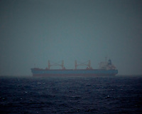 Cargo Ship on a Rainy Day. Image taken with a Nikon 1 V3 camera and 70-300 mm VR lens.