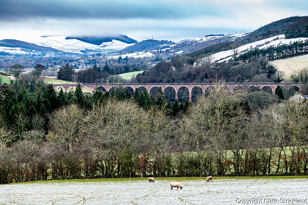 Melrose, Scottish Borders, UK. 9th January 2020. The north westerly view from Ravenswood across the River Tweed and the Leaderfoot viaduct, as snow lies on the hills above Melrose in the Scottish Borders.