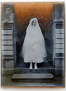 deteriorating first communion portrait France circa 1920s