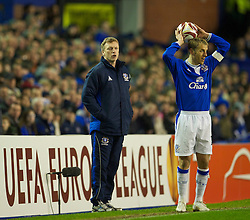 LIVERPOOL, ENGLAND - Tuesday, February 16, 2010: Everton's manager David Moyes and captain Phil Neville during the UEFA Europa League Round of 32 1st Leg match against Sporting Clube de Portugal at Goodison Park. (Photo by: David Rawcliffe/Propaganda)