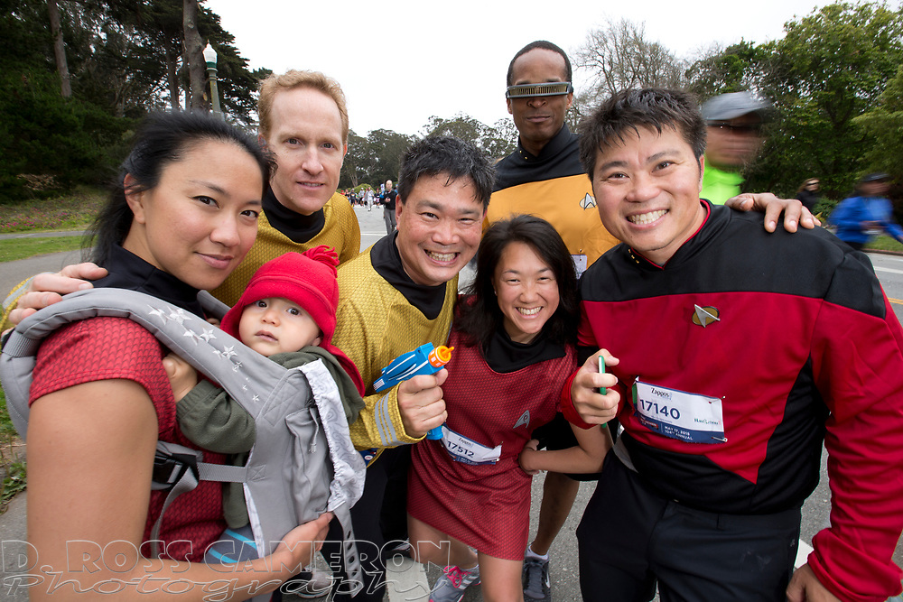 A group of joggers dressed as characters from the Star Trek franchise set their phasers on stun before having their picture made, during the 104th running of the Bay to Breakers 12k, Sunday, May 17, 2015 in San Francisco. Tens of thousands of runners, some clad in costume and some in nothing at all, populated the 7.42-mile route. (D. Ross Cameron/Bay Area News Group)