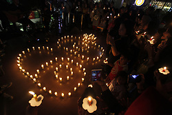 March 30, 2019 - Bogor, West Java, Indonesia - A number of visitors to the shopping center lit candles while commemorating Earth Hour in Bogor, West Java, Indonesia, on March 30, 2019. Shopping centers in Bogor invited all visitors to jointly start implementing energy-efficient lifestyles. (Credit Image: © Adriana Adie/NurPhoto via ZUMA Press)