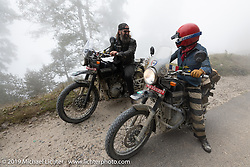 Danger Dan Hardick and Danita Gayle riding side by side on Motorcycle Sherpa's Ride to the Heavens motorcycle adventure in the Himalayas of Nepal. Riding from Chitwan to Daman. Tuesday, November 12, 2019. Photography ©2019 Michael Lichter.
