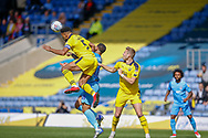 Oxford United defender Curtis Nelson (5) beats Coventry City forward Jonson Clarke-Harris (18) to the ball during the EFL Sky Bet League 1 match between Oxford United and Coventry City at the Kassam Stadium, Oxford, England on 9 September 2018.