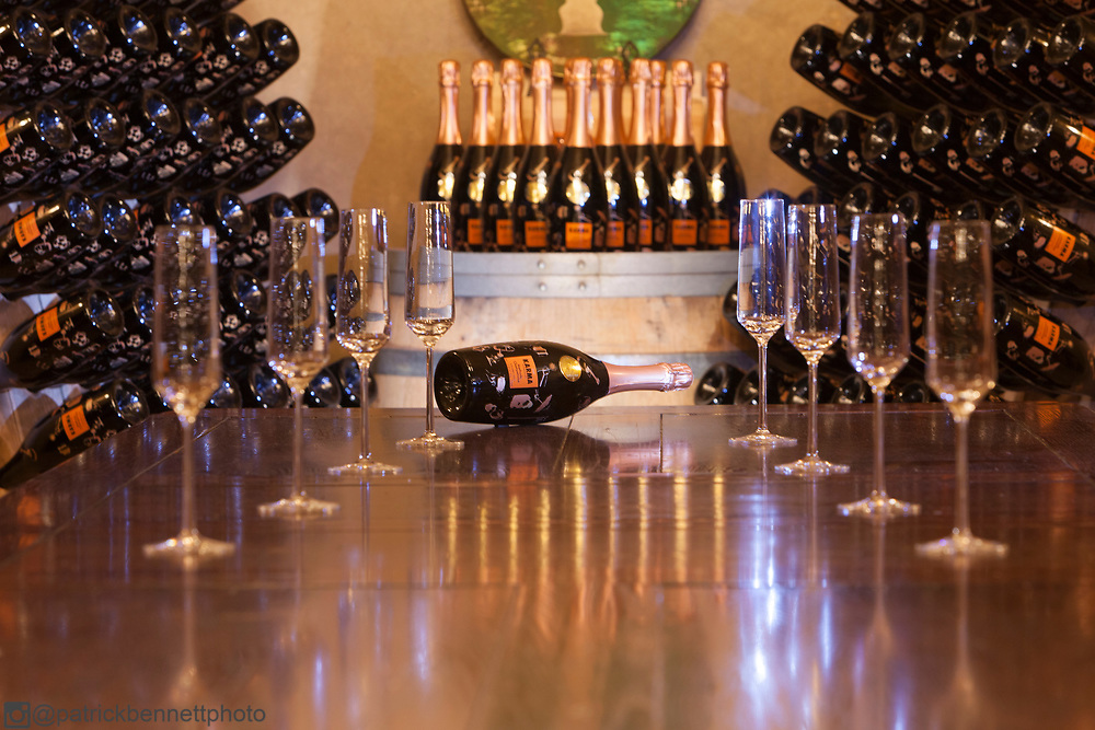 A bottle of the famous Karma champagne sits on the table on it's side in the tasting room in the Karma Cave.
