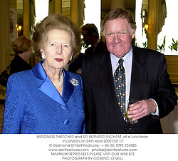 BARONESS THATCHER and SIR BERNARD INGHAM, at a luncheon in London on 24th April 2002.OZI 13