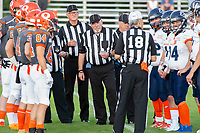 KELOWNA, BC - AUGUST 3:  Referees stand at centre field between the Okanagan Sun and Kamloops Broncos  at the Apple Bowl on August 3, 2019 in Kelowna, Canada. (Photo by Marissa Baecker/Shoot the Breeze)
