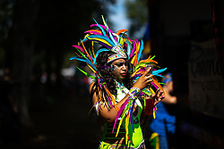 © Licensed to London News Pictures . 11/08/2018. Manchester , UK . The annual Moss Side Caribbean Carnival procession , celebrating dance , music and Afro-Caribbean culture , which passes in a loop from Alexandra Park and through the streets of Moss Side . Photo credit : Joel Goodman/LNP