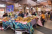 Venders selling locally produced items at the Santa Fe Farmers Market in the historic district December 12, 2015 in Santa Fe, New Mexico.