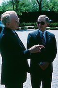 Roger Smith, CEO of General Motors with Ross Perot, now arch enemies but once Perot was GM's biggest private stockholder after they bought out his company EDS.