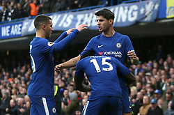 """Chelsea's Alvaro Morata (back right) celebrates scoring his side's second goal of the game during the Premier League match at Stamford Bridge, London. PRESS ASSOCIATION Photo Picture date: Saturday December 2, 2017. See PA story SOCCER London. Photo credit should read: Steven Paston/PA Wire. RESTRICTIONS: EDITORIAL USE ONLY No use with unauthorised audio, video, data, fixture lists, club/league logos or """"live"""" services. Online in-match use limited to 75 images, no video emulation. No use in betting, games or single club/league/player publications."""