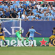 Chris Duvall, New York Red Bulls, scores his sides second goal beating goalkeeper Josh Saunders, NYCFC, during the New York City FC Vs New York Red Bulls, MSL regular season football match at Yankee Stadium, The Bronx, New York,  USA. 28th June 2015. Photo Tim Clayton