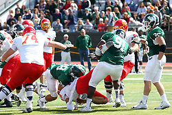 19 September 2015:  Will James pulls Davey Jurgens back as Kevin Slawkowski tries to put him in the turf during an NCAA division 3 football game between the Simpson College Storm and the Illinois Wesleyan Titans in Tucci Stadium on Wilder Field, Bloomington IL