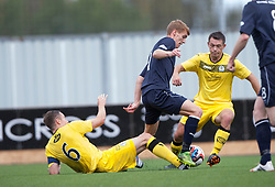 Queen of the South's Chris Higgins, Falkirk's Jay Fulton andQueen of the South's Derek Young.<br /> half time : Falkirk 1 v 0 Queen of the South, Scottish Championship 5/10/2013.<br /> ©Michael Schofield.