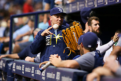 July 6, 2017 - St. Petersburg, Florida, U.S. - WILL VRAGOVIC   |   Times.Tampa Bay Rays catcher Jesus Sucre (45) plays catch wearing a glove he borrowed from fan Tony Voda during the game between the Boston Red Sox and the Tampa Bay Rays at Tropicana Field in St. Petersburg, Fla. on Thursday, July 6, 2017. (Credit Image: © Will Vragovic/Tampa Bay Times via ZUMA Wire)