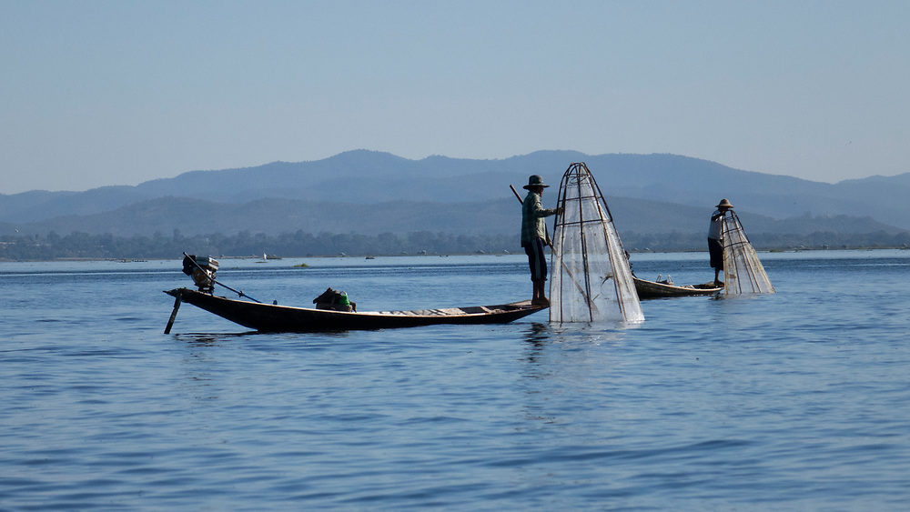 These fishermen belong to the Intha people, who are the main tribe that lives around Inle Lake. The Intha (which translates to 'lake people' in Burmese) Standing on the end of the boat they have a great view and can lead the way better