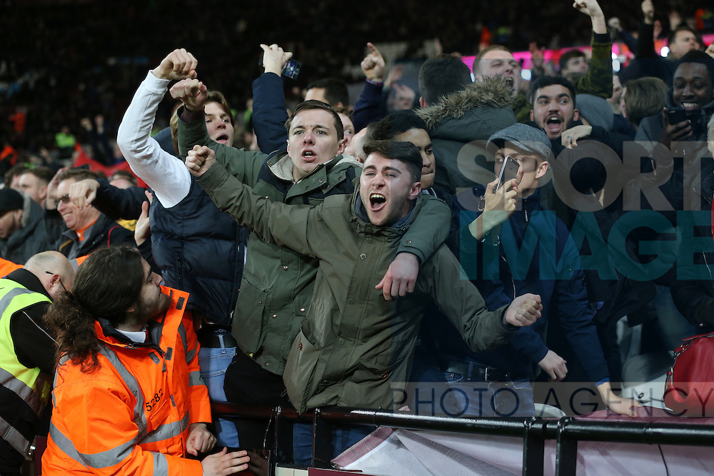 Arsenal's fans celebrates their sides fifth goal as stewards hold them back during the Premier League match at the London Stadium, London. Picture date December 3rd, 2016 Pic David Klein/Sportimage