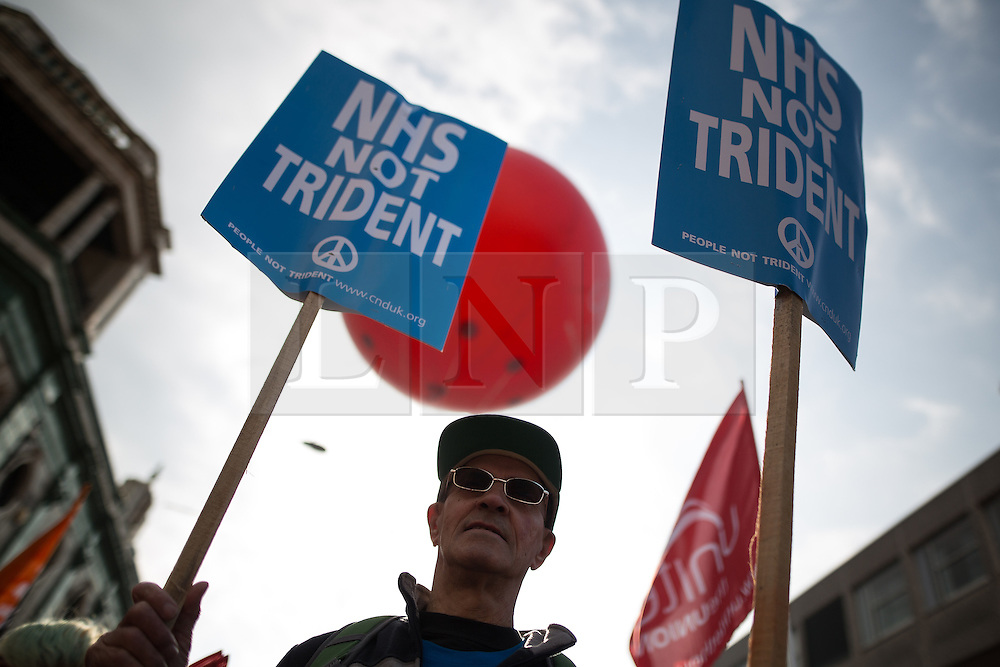 © Licensed to London News Pictures . 04/10/2015 . Manchester , UK . A demonstration against the Conservative government , organised by The People's Assembly , through Manchester City Centre , during the first day of the Conservative Party Conference in Manchester . Photo credit: Joel Goodman/LNP