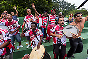 "Sao Paulo amateur ""Várzea"" Championship between Colorado and Santa Cruz teams in Villa Formosa district, Sao Paulo city. Fans sing and dance to a Samba beat in support  of their team. `The amateur ""Várzea""championship was born before the professional  game took hold throughout Brazil and its roots lie in the city of Sao Paulo, the creator of such a championship, which is fiercely contested by all teams that participate in the competition. It is wholly amateur and is funded ans supported by local businesses to the teams that participate."