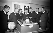 22/03/1966<br /> 03/22/1966<br /> 22 March 1966<br /> Northern Ireland tourist Board Exhibition at the Little Theatre, Brown Thomas in Dublin. Picture shows Mr patrick Moore (3rd from right), Director, Armagh Observatory, showing a model of the planned Armagh Planetarium to l-r: Mr Brendan O'Regan, Chairman of Bord Failte; Mr Brian Faulkner, Northern Ireland Minister of Commerce; Alderman Eugene Timmons, Lord Mayor of Dublin; Mr Erskine Childers, Minister for Transport and Power, who opened the exhibition and Mr W.L. Stephens, Chairman Northern Ireland Tourist Board. Gentleman on far right is unnamed.
