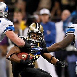 January 7, 2012; New Orleans, LA, USA; New Orleans Saints running back Pierre Thomas (23) is pursued by Detroit Lions defensive end Kyle Vanden Bosch (93) and linebacker Stephen Tulloch (55) during the 2011 NFC wild card playoff game at the Mercedes-Benz Superdome. Mandatory Credit: Derick E. Hingle-US PRESSWIRE