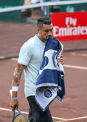 April 13, 2018 - Houston, TX, U.S. - HOUSTON, TX - APRIL 13:  Nick Kyrgios of Australia crosses the court in the match against Ivo Karlovic of Croatia during the Quarterfinal round of the Men's Clay Court Championship on April 13, 2018 at River Oaks Country Club in Houston, Texas.  (Photo by Leslie Plaza Johnson/Icon Sportswire) (Credit Image: © Leslie Plaza Johnson/Icon SMI via ZUMA Press)