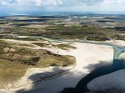 Nederland, Noord-Holland, Texel, 16-04-2012; Ingang van De Slufter, gezien in oostelijke richting, vanaf de Noordzee naar de Polder Eijerland..Het natuurgebied, een duinvalllei met kreken, is ontstaan doordat de duinen in het verleden doorgebroken zijn. De Sluftervallei staat in open verbinding met de Noordzee en wordt beïnvloed door eb en vloed..Entrance to natural area The Slufter, beach and dunes of the isle of Texel. Polder in the back..luchtfoto (toeslag), aerial photo (additional fee required);.copyright foto/photo Siebe Swart