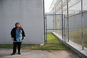 """Sara Garcia stands in front of the Travis County Correctional Facility where her son Mark, 21, is currently awaiting sentencing for his second term of incarceration.<br /> <br /> """"I never thought my son would be incarcerated. He was such a good kid growing up. I expected to be planning for girlfriends and prom and graduation. I got none of that. I didn't get to see him grow up. He hasn't lived and he's going up in the state penitentiary.""""<br /> <br /> Sara Garcia's son Mark has been incarcerated since he was 16 and has spent two and a half years in solitary confinement. Her son's mental illness combined with long stretches in solitary has left him only more disturbed and despondent. After being released in late 2014, Mark struggled to stay sober and hopeful, even with the extensive support network his mother had waiting for him. He returned to prison just four months later on another charge and will likely be behind bars for several more decades."""
