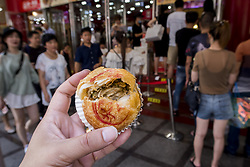 August 3, 2017 - Shanghai, Shanghai, China - Shanghai, CHINA-August 3 2017: (EDITORIAL USE ONLY. CHINA OUT) ..As the Mid-Autumn Festival approaches, the moon-cake with stuffing of sauerkraut and bullfrog can be seen in Shanghai, August 3rd, 2017. (Credit Image: © SIPA Asia via ZUMA Wire)