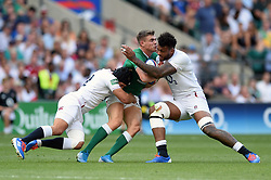 Luke McGrath of Ireland is double-tackled by Piers Francis and Courtney Lawes of England - Mandatory byline: Patrick Khachfe/JMP - 07966 386802 - 24/08/2019 - RUGBY UNION - Twickenham Stadium - London, England - England v Ireland - Quilter International