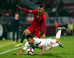 LISBON, Nov. 21, 2018  Rafa Silva (top) of Portugal vies with Bartosz Bereszynski of Poland during the UEFA Nations League soccer match League A Group 3 in Guimaraes, Portugal on Nov. 20, 2018. The match ended with a 1-1 tie. (Credit Image: © Catarina Morais/Xinhua via ZUMA Wire)
