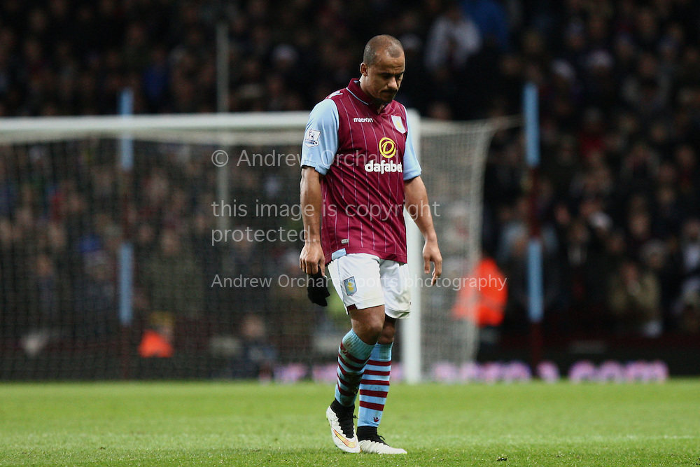 Gabby Agbonlahor of Aston Villa looks dejected as he leaves the field after receiving a red card for a foul on Ashley Young. Barclays Premier league match, Aston Villa v Manchester Utd at Villa Park in Birmingham on Saturday 20th December 2014<br /> pic by Mark Hawkins, Andrew Orchard sports photography.