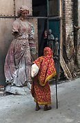 """The settlement of Kumartuli - or """"potter locality"""" - lies besidethe Ganges in theolder, northern part of Calcutta.Over 300 years old, todayaround 150 families live here, earning a living by sculpting idols forDurga Puja andvarious other festivals.Gangamaati- mud from the Ganges - is also used to make clay, and along with straw and bamboo the statues are crafted by hand."""