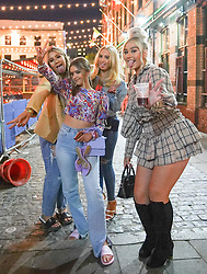 © Licensed to London News Pictures. 17/04/2021. Liverpool, UK. Revellers pose for a photograph as they enjoy the first weekend in Liverpool city centre after lockdown restrictions were eased Photo credit:  Ioannis Alexopoulos/LNP