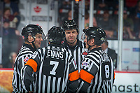 REGINA, SK - MAY 23: Referees and linesmen stand at center ice at the Brandt Centre on May 23, 2018 in Regina, Canada. (Photo by Marissa Baecker/CHL Images)