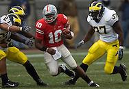 MORNING JOURNAL/DAVID RICHARD&#xA;Troy Smith breaks through the Michigan defense.<br />