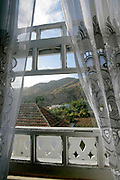 A window in a colonial building in Brava's capital village Nova Sintra. This village is a gem of simple colonial architecture featuring humble houses in a plateau about 600 metres from sea level.