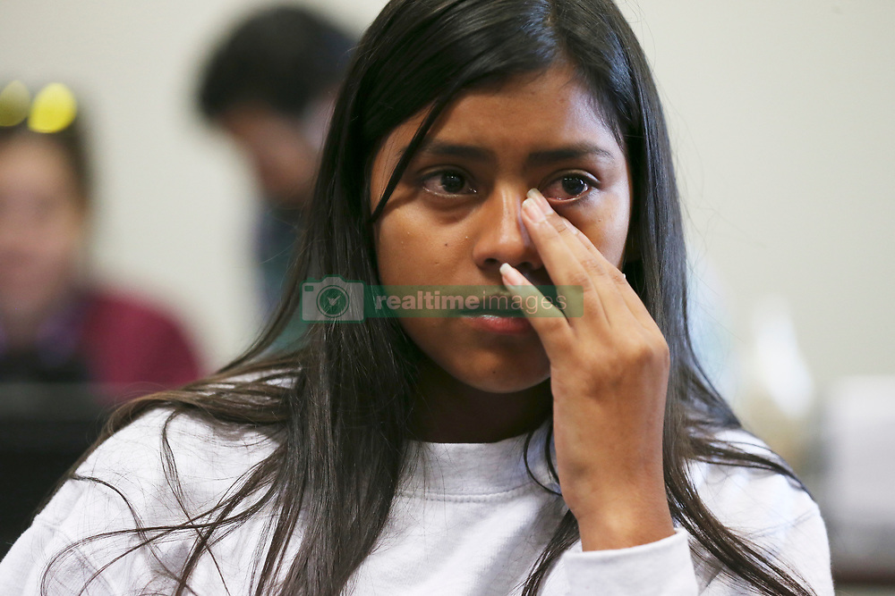 July 26, 2018 - San Antonio, Texas, U.S. - CRISTHEL NOHELIA BARAHONA SANCHEZ, 15, wipes tears while talking with media at the Archdiocese of San Antonio Catholic Charities offices, Thursday. Sanchez and her mother Sandra Elizabeth Sanchez, 44, were separated after being caught by U.S. Border Patrol in Eagle Pass on June 18th. Sanchez reunited with her daughter Wednesday night after they were released and are headed to Washington State where her older daughter and three grandchildren live. Three days before they were caught, Cristhel celebrated her 15th birthday along the route in Mexico. People around them pitched in and bought her a 'pastelito'. (Credit Image: © Jerry Lara/San Antonio Express-News via ZUMA Wire)