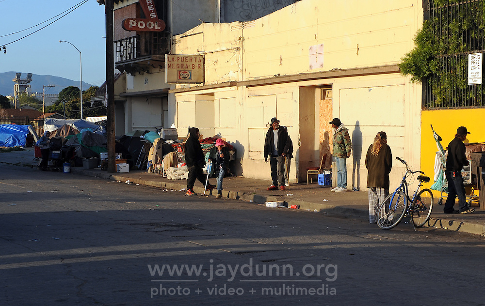 The morning sun reaches parts of Soledad Street in Salinas, prior to a cleanup of the area by city authorities.